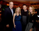 "LOS ANGELES, CA - JANUARY 12: (L-R) Gary Newman, Co-Chairman-CEO, Fox Television Group, actress Gillian Anderson, actor David Duchovny and Dana Walden, Co-Chairman-CEO, Fox Television Group pose at the after party for the premiere of Fox's ""The X-Files"" at the California Science Center on January 12, 2016 in Los Angeles, California. (Photo by Kevin Winter/Getty Images)"